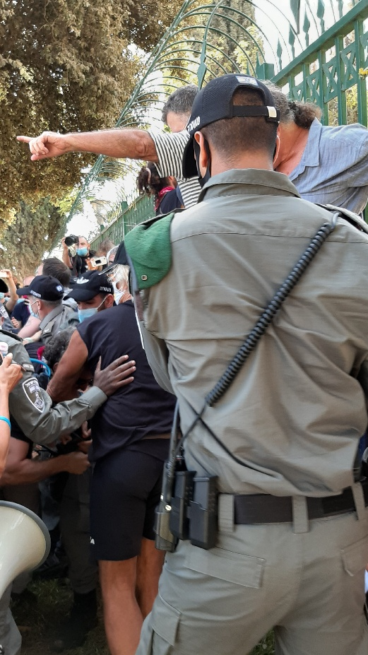 Knesset protest. Police attacking banner and its protectors